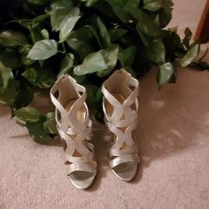 Brand new silver Cage style Wedge Heels